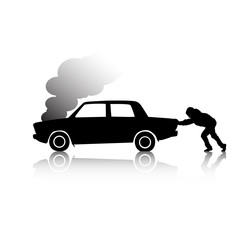 Silhouette of man pushing a broken car