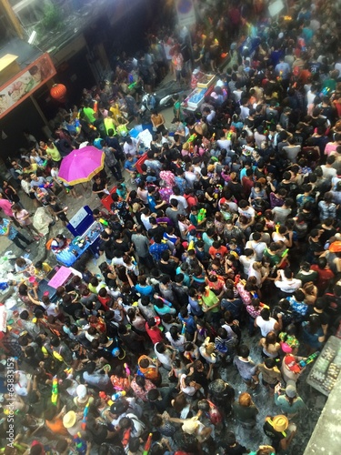Tourists in Songkran featival at Silom road Bangkok Thailand