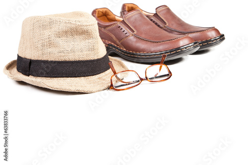 Glasses shoes and hat isolated on white