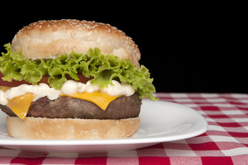 Homemade Hamburger on black background