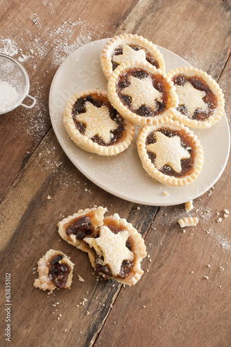 Eating tasty home baked Christmas mince pies