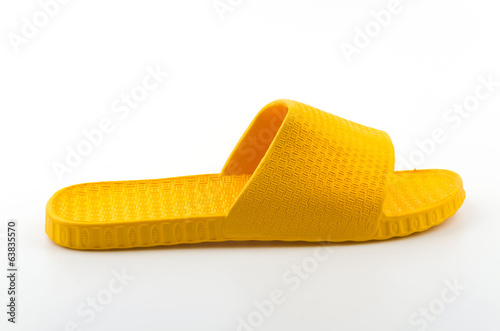 Yellow slippers isolated white background