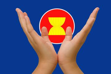 Open hands holding  icon of Asean Economic Community