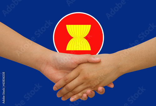 ASEAN Economic Community in businessman handshake