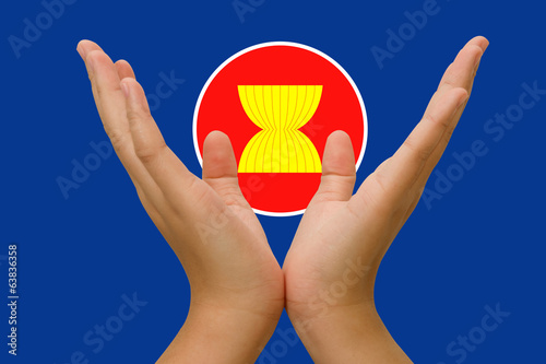 Open hands holding  icon of Asean Economic Community