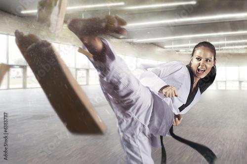 Fototapeta Applying focus and power (Martial arts)