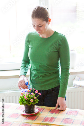 Young girl taking care of flower