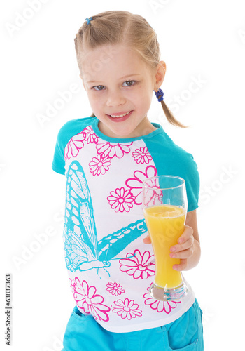 Cute little girl drinks orange juice