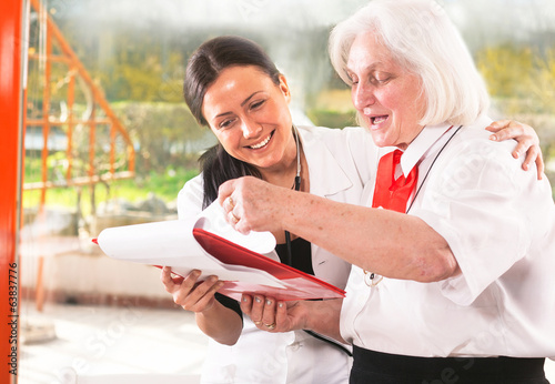 senior woman with a nurse