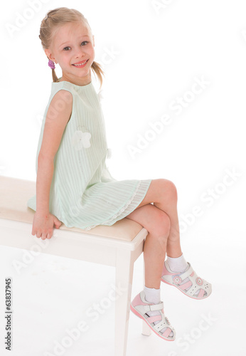 Portrait of sitting little girl.