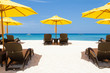 Yellow sun umbrellas and beach chairs