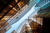 Fototapeta Upwards perspective of glass commercial skyscrapers, Hong Kong