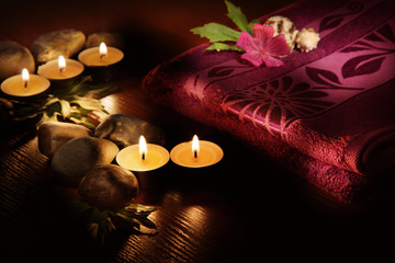 Towel and aromatic candles