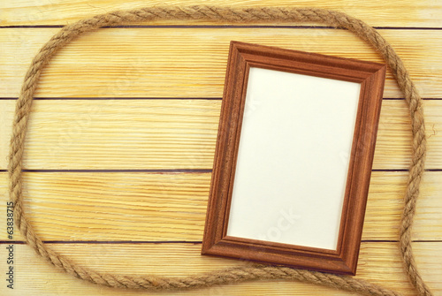 Photo frame on the background of wooden slats
