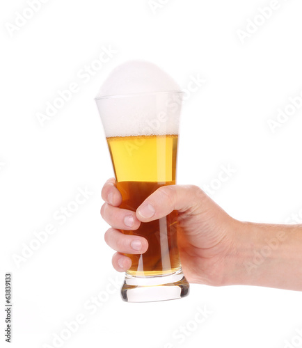 Hand with a beer glass.