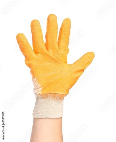 Hand in rubber glove shows four.