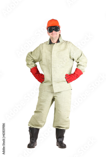 Smiling welder in glasses and red helmet.