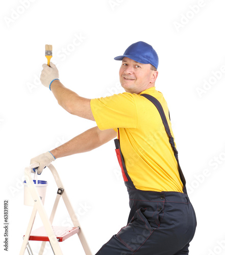 Worker on ladder with paintbrush.