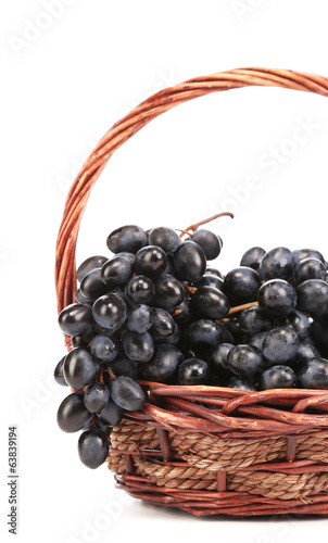 Dark grapes in a wicker basket.