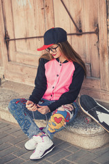 Hipster young girl with skate board