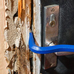 Hack the door with a crowbar