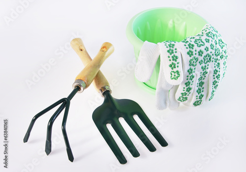 Gardening tools on light background