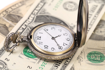 Pocket watch on money.