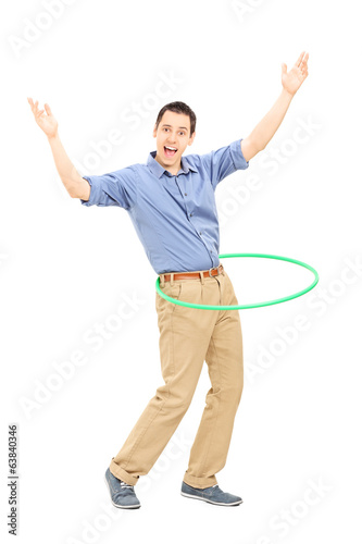Young man exercising with hula hoop