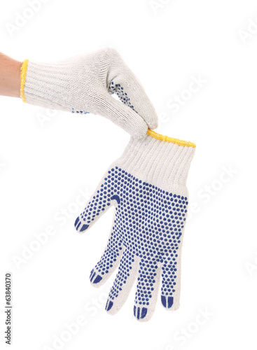 Hand holds protective gloves with blue circles.