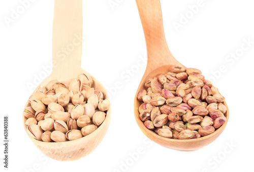 Wooden spoons of pistachios.