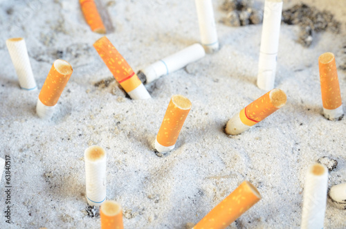 cigarette stub in the sand