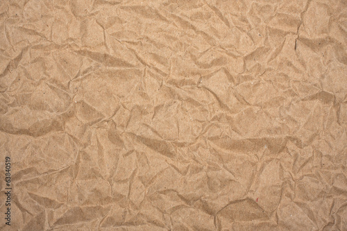 Crumpled packaging brown paper as background