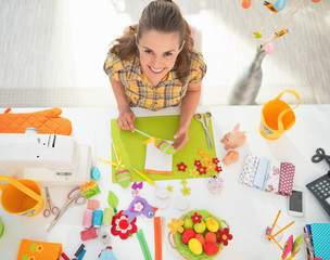 Young woman making easter decoration