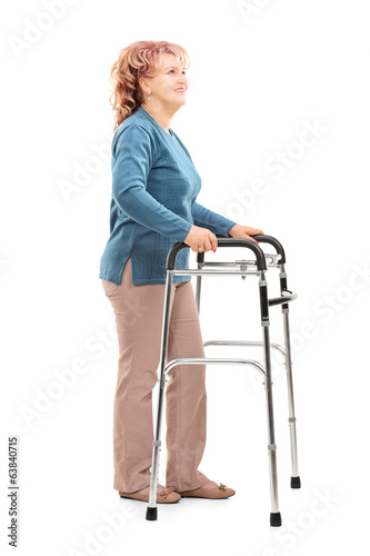 Mature woman with walker looking up