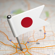 Japan Small Flag on a Map Background.