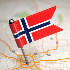 Norway Small Flag on a Map Background.