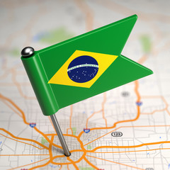 Brazil Small Flag on a Map Background.