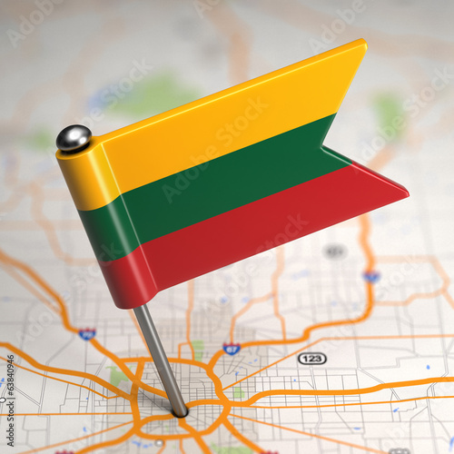 Lithuania Small Flag on a Map Background.