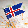 Iceland Small Flag on a Map Background.