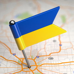 Ukraine Small Flag on a Map Background.