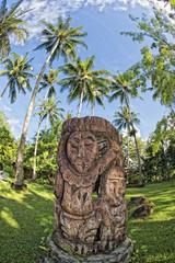 wooden tiki on tropical paradise beach