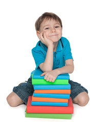 Cute young boy with books