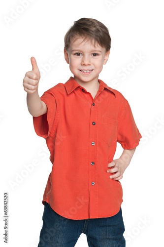 Young boy in the red shirt holds his thumb up