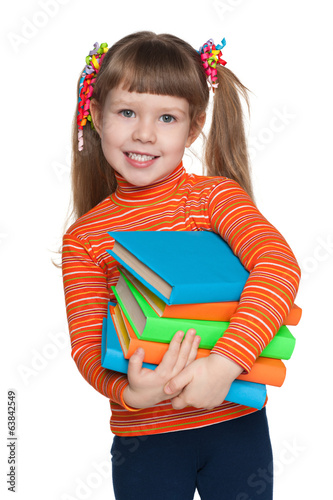 Happy little girl with books