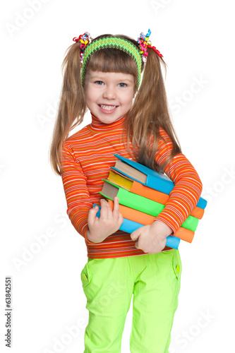 Cheerful little girl with books