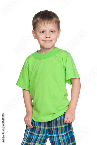 Happy little boy in the green shirt