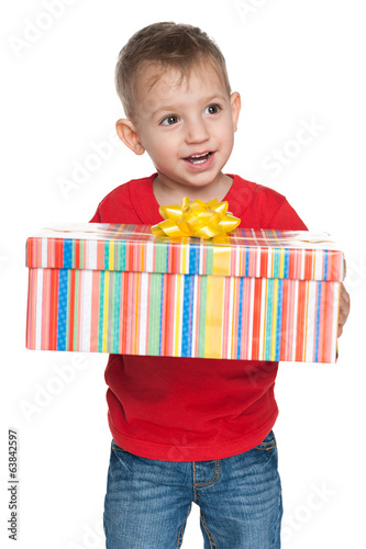 Cute little boy with a gift box
