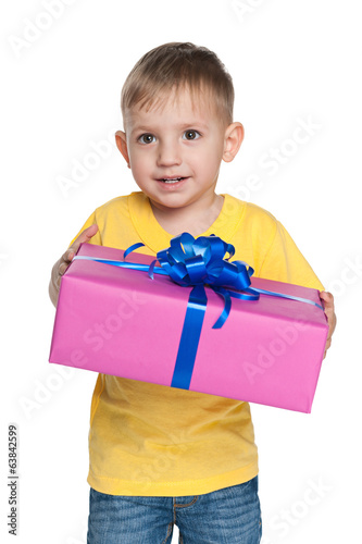 Cute little boy holds a gift box