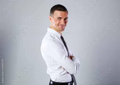 Portrait of a happy businessman with arms folded