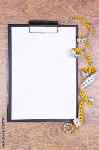 blank clipboard and measure tape on the table